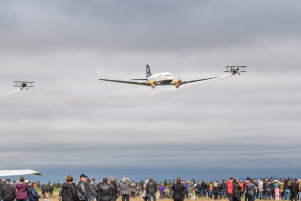 """The formation flight of DC-3 TF-NPK (in center) with Pitts S-1S TF-ABJ (on the left) and Pitts S-2AE TF-TOP (on the right) during the """"Allt sem flýgur 2019"""" in Hella // Source: Andres Thorarinsson"""
