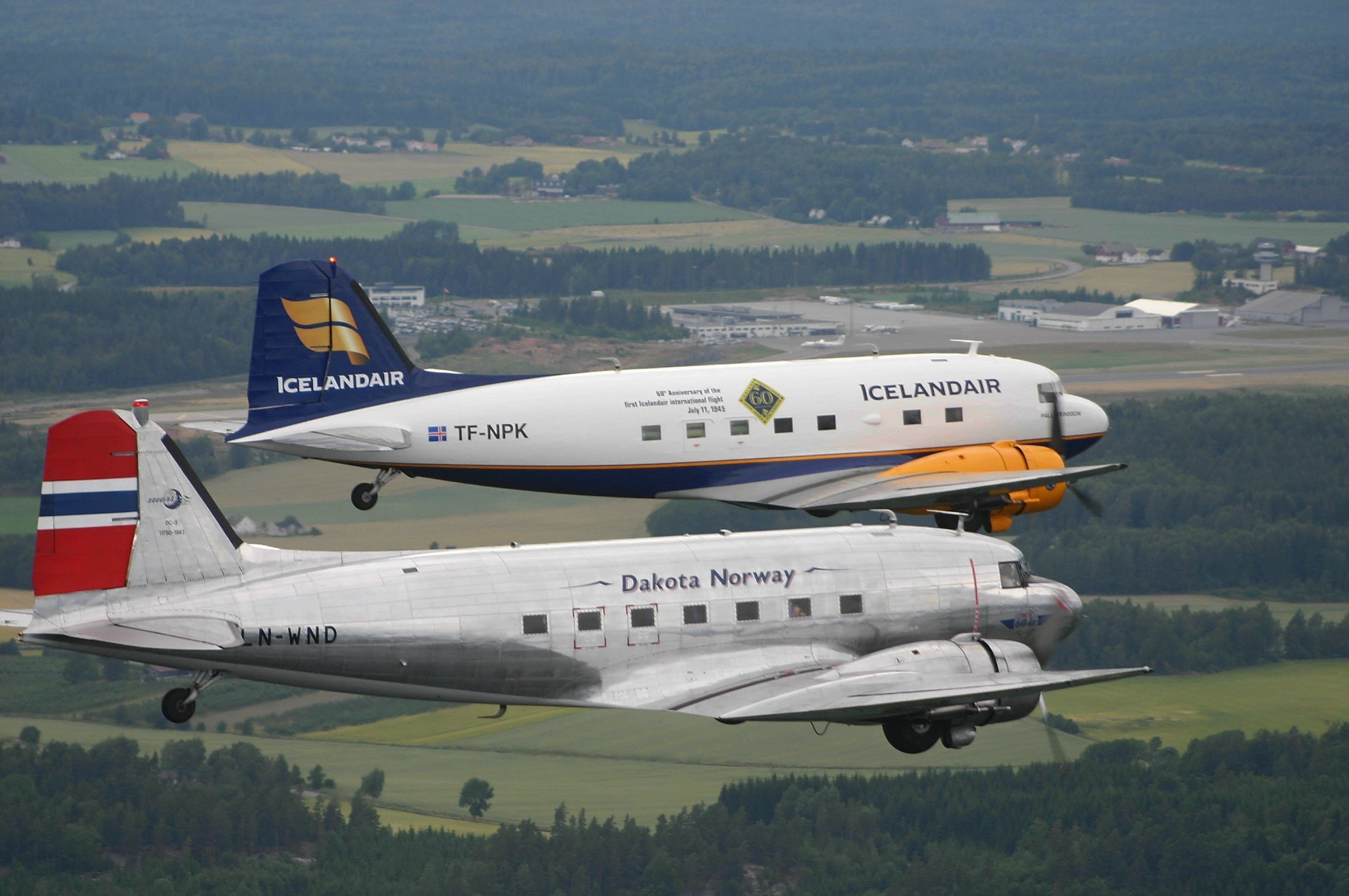 Icelandic DC-3 TF-NPK and Norwegian LN-WND during formation flight over Sandefjörd, Norway // Source: Tómas Dagur Helgason