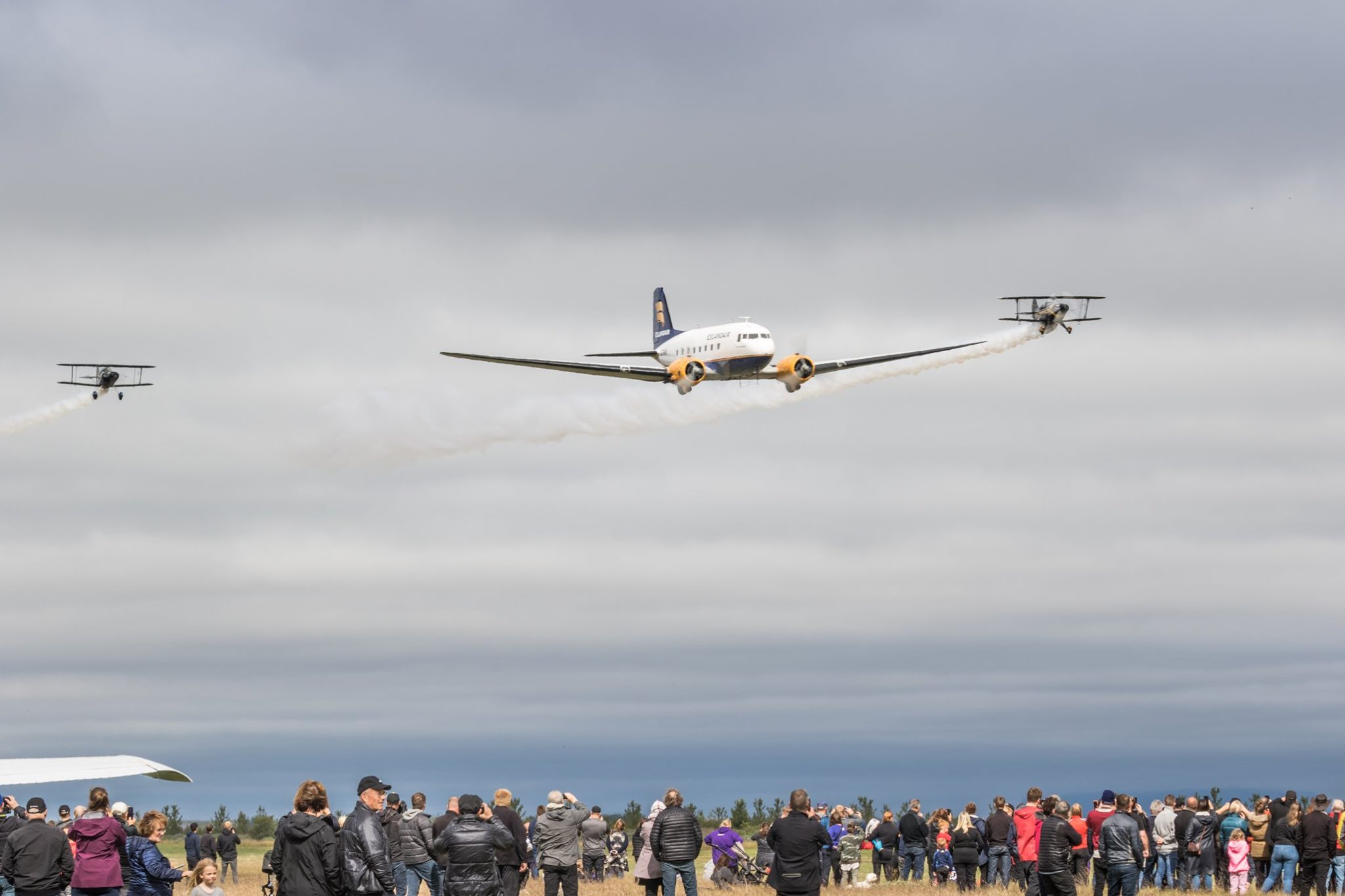 "The formation flight of DC-3 TF-NPK (in center) with Pitts S-1S TF-ABJ (on the left) and Pitts S-2AE TF-TOP (on the right) during the ""Allt sem flýgur 2019"" in Hella // Source: Andres Thorarinsson"
